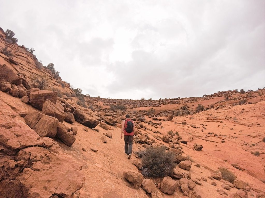 Hauling up the last leg of a hike to beat an incoming storm