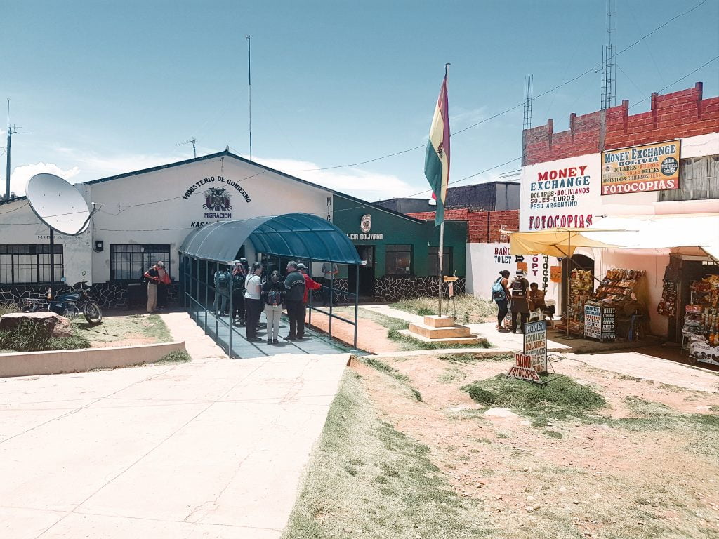 The Bolivian migration office is located on the left side of the road through the big arch
