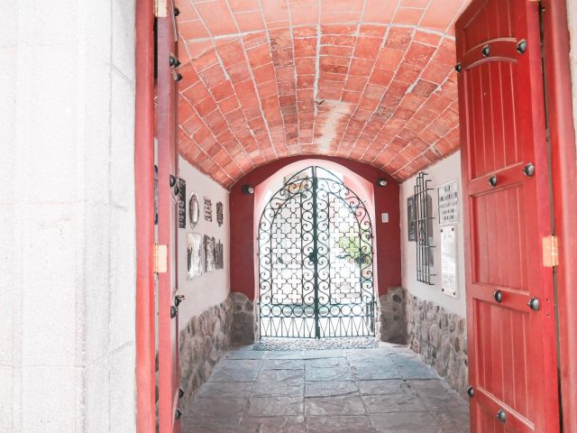 A red door marks the entry to the old house of Bolivian leader Pedro Domingo Murillo. This is now a museum in his honor.