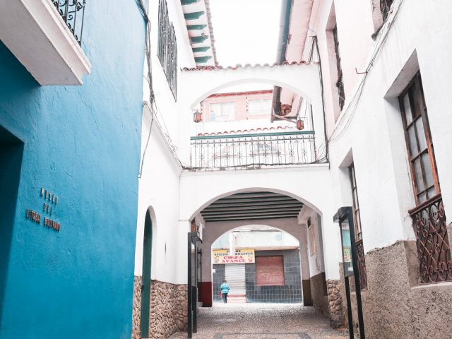 A series of arches mark the upper end of Calle Jaen that leads out to a bustling street