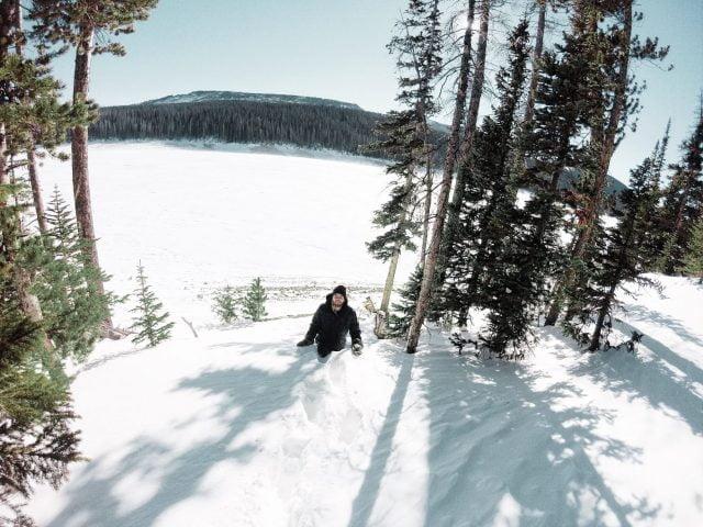 Trudging through the waist-deep snow near Joe Wright Reservoir
