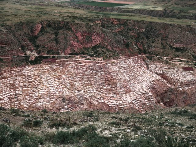 The many salt mines on the hillside are still used by community members today