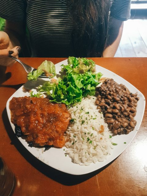 Rice, beans, salad, and stewed beef for the second course