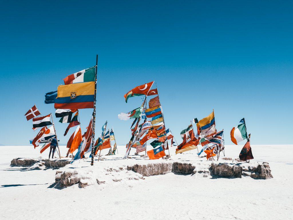 World flags on the Salar de Uyuni Tour