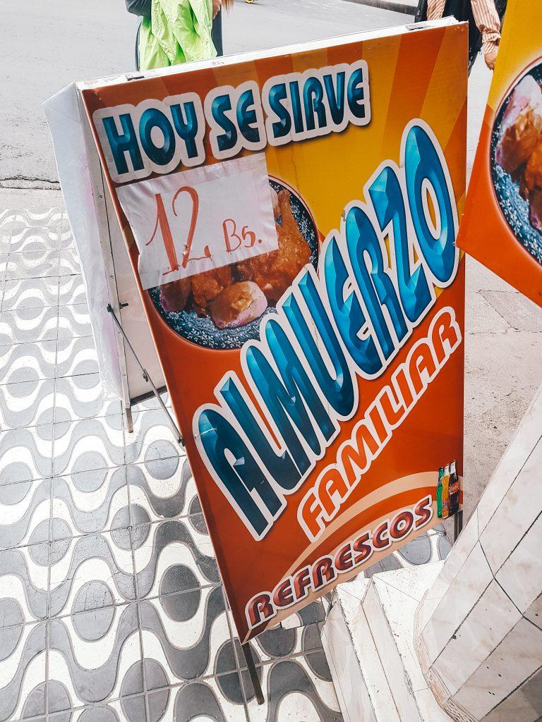 Sign advertising the menu del día, or almuerzo familiar