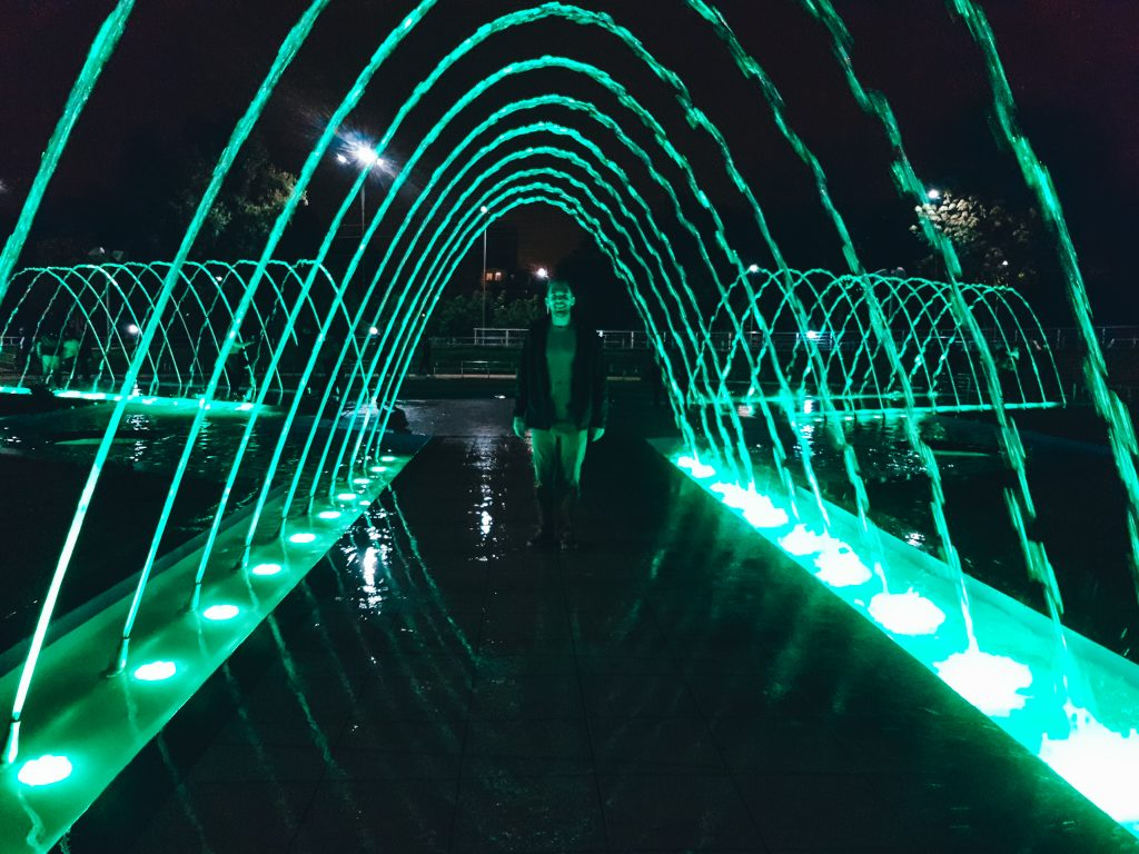 Matt walking through one of the water features at Parque de la Familia