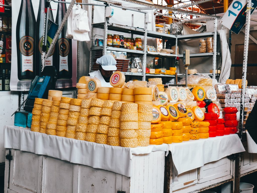 So many cheese wheels and other food options at the local market