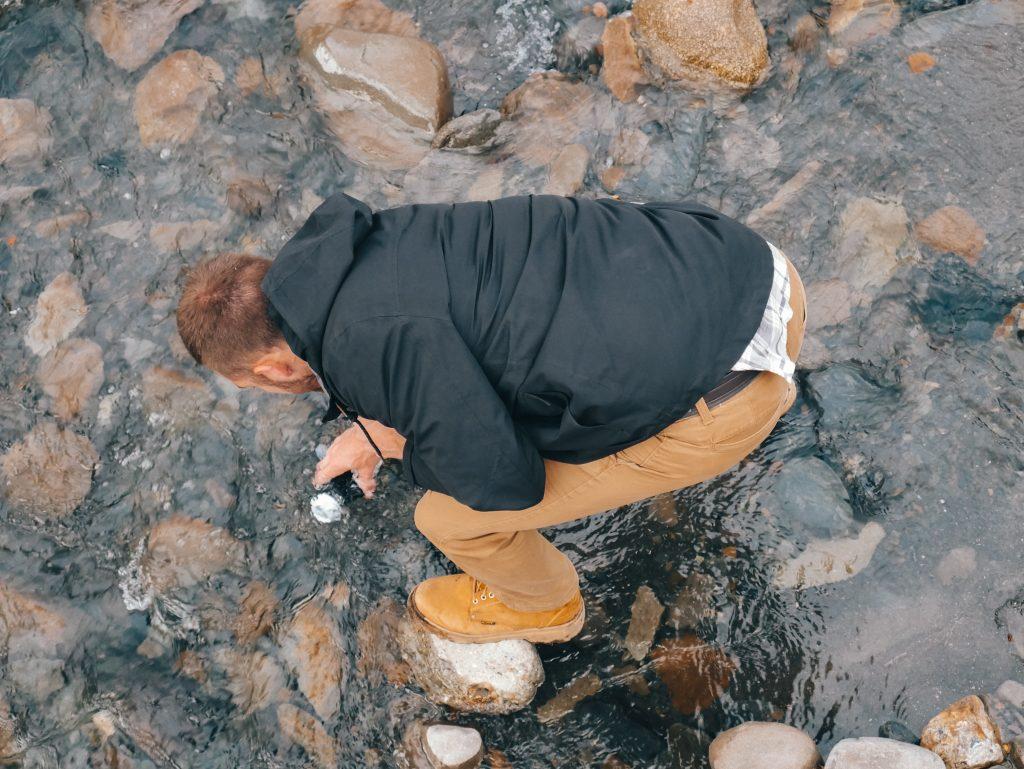 Matt filling our bottle in the river