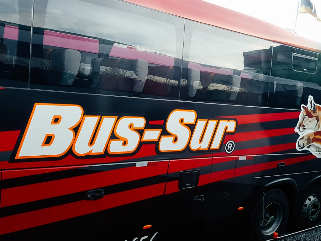 The side of a large Bus Sur bus